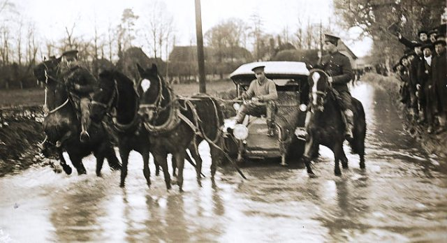 Amesbury, Great Britain - April 12 - Soldiers make their way through the flooded streets during one of the wettest periods in Salisbury Plain history. Photo by TL Fuller. At the outbreak of WW1, most Canadian soldiers came over to England and the Salisbury Plain (in the south) area for their final training before being shipped out to Belgium and France. The nearby town of Amesbury has a long and storied tradition with the military. April 12, 2014